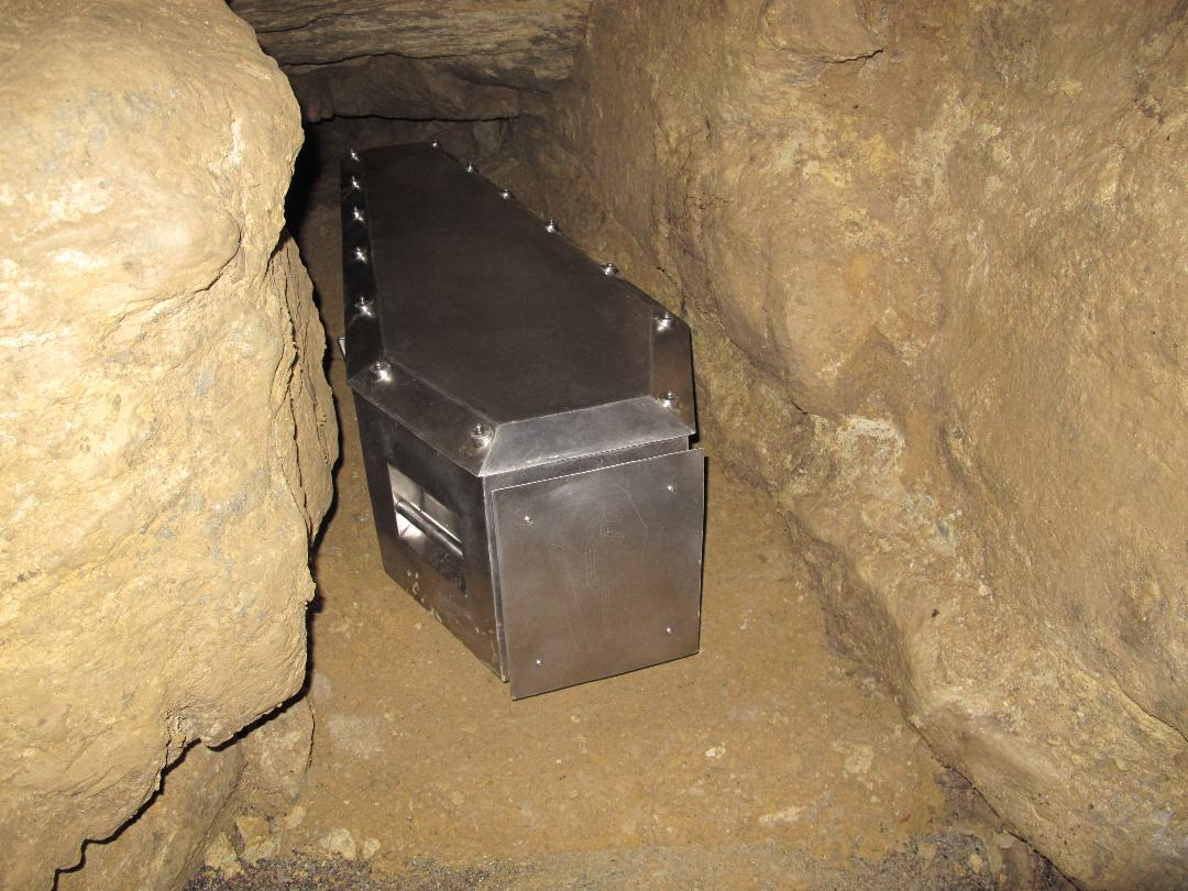 The Ackerman Burial Coffin placed in the cave system which will be its final resting place.